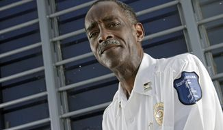 FILE - In this Sept. 1, 2010 file photo, Capt. Robert Johnson is photographed outside of the guard house at the Lee Correctional Institution, in Bishopville, S.C. Johnson, an ex-South Carolina corrections officer who was nearly killed in a hit orchestrated by an inmate using an illegal cellphone is asking federal authorities for help to make sure nothing like it happens again. Robert Johnson is scheduled to testify Thursday before the Federal Communications Commission about preventing inmate access to cellphones.  (AP Photo/Brett Flashnick, File)