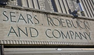 "Sears signage is shown on its department store in Brooklyn's Flatbush neighborhood, Wednesday, March 22, 2017, in New York. Sears, once the monolith of American retail, says that there is ""substantial doubt"" that it will be able to keep its doors open. Company shares tumbled more than 12 percent Wednesday. (AP Photo/Bebeto Matthews)"