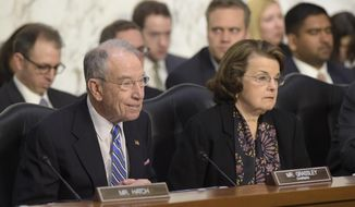 Senate Judiciary Committee Chairman Sen. Charles Grassley, R-Iowa., left, and the committee's ranking member Sen. Dianne Feinstein, D-Calif., listen to testimony from Supreme Court Justice nominee Neil Gorsuch as he testifies on Capitol Hill in Washington, Tuesday, March 21, 2017, during his confirmation hearing before the committee. (AP Photo/Susan Walsh)
