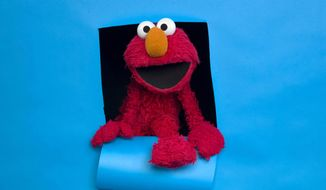 """FILE - In this Jan. 24, 2011, file photo, Elmo of the film """"Being Elmo"""" poses for a portrait in the Fender Music Lodge during the 2011 Sundance Film Festival in Park City, Utah. A viral video posted online Friday, March 17, 2017, imagined Elmo getting fired from """"Sesame Street"""" due to PBS budget cuts. (AP Photo/Victoria Will, File)"""