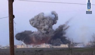 This frame grab from video provided on Wednesday March 22, 2017, by Ibaa news agency, the communications arm of the al Qaeda-linked, Levant liberation committee, outlet that is consistent with independent AP reporting, shows black smoke rising after a suicide bomber from the militant group of Levant Liberation Committee, blowup himself at a Syrian government forces position, in Souran Town, northern Hama, Syria. Insurgents advanced on government-held towns and positions north of the central city of Hama. An al-Qaida-linked group spearheaded the assault, launched Tuesday, by detonating a car bomb in the nearby town of Souran. (Ibaa News Agency, via AP)