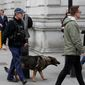 A police dog handler patrolled near the Houses of Parliament in London on Thursday on her way to the House of Parliament. On Wednesday a man went on a deadly rampage, first driving a car into pedestrians then stabbing a police officer to death. (Associated Press)