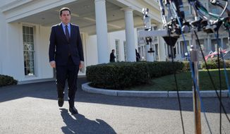 House Intelligence Committee Chairman Rep. Devin Nunes, California Republican, walks out of the White House in Washington on Wednesday to speak with reporters after a meeting with President Trump. (AP Photo/Pablo Martinez Monsivais) (Associated Press)