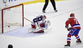 Washington Capitals right wing T.J. Oshie (77) scores a goal against Columbus Blue Jackets goalie Sergei Bobrovsky during the shootout of an NHL hockey game Thursday, March 23, 2017, in Washington. The Capitals won 2-1. (AP Photo/Nick Wass)