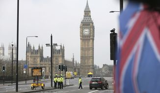 Police work at Westminster Bridge with the Houses of Parliament in background, in London, Thursday March 23, 2017. On Wednesday a knife-wielding man went on a deadly rampage, first driving a car into pedestrians on Westminster Bridge then stabbing a police officer to death before being fatally shot by police within Parliament's grounds in London. (AP Photo/Tim Ireland)