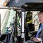 President Donald Trump jokes as he sits in the drivers seat of an 18-wheeler as he meets with truckers and CEOs regarding healthcare on the South Lawn of the White House, Thursday, March 23, 2017, in Washington. (AP Photo/Andrew Harnik)