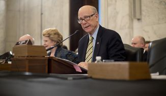 Senate Agriculture, Nutrition and Forestry Committee Chairman Sen. Pat Roberts, R-Kan. speaks on Capitol Hill in Washington, Thursday, March 23, 2017, prior to the start of the committee's confirmation hearing for Agriculture Secretary-designate Sonny Perdue. The committee's ranking member Sen. Debbie Stabenow, D-Mich. is at left. (AP Photo/Pablo Martinez Monsivais)