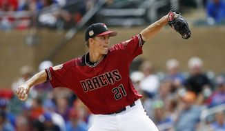 Arizona Diamondbacks' Zack Greinke throws a pitch against the Chicago Cubs during the first inning of a spring training baseball game Thursday, March 23, 2017, in Scottsdale, Ariz. (AP Photo/Ross D. Franklin)