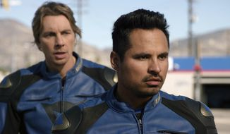 """This image released by Warner Bros. Pictures shows Michael Pena, foreground, and Dax Shepard in a scene from, """"CHiPS."""" (Warner Bros via AP)"""