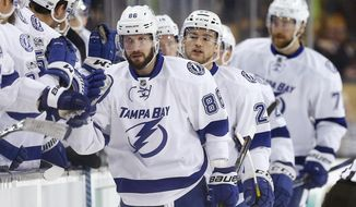 Tampa Bay Lightning's Nikita Kucherov (86), of Russia, celebrates his goal during the second period of an NHL hockey game against the Boston Bruins in Boston, Thursday, March 23, 2107. (AP Photo/Michael Dwyer)