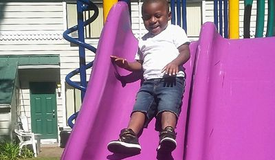 This July 2016 photo provided by Pamela Harris shows Reginald Kendall Harris Jr., playing on a slide at a park in Portland, Ore. Reginald died Oct. 10, 2016, after swallowing methadone. His uncle has been charged in his death, accused of leaving the methadone where the boy had access to it. The number of children's deaths is still small relative to the overall toll from opioids, but toddler fatalities have climbed steadily over the last 10 years. (Pamela Harris via AP)