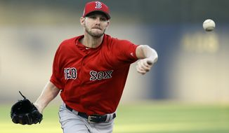 Boston Red Sox starting pitcher Chris Sale throws in the first inning in a spring training baseball game against the New York Yankees, Tuesday, March 21, 2017, in Tampa, Fla. (AP Photo/John Raoux)