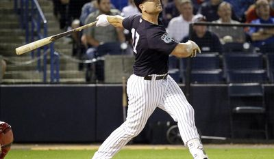 New York Yankees' Matt Holliday hits a 2-run home run in the sixth inning against the Boston Red Sox in a spring training baseball game, Tuesday, March 21, 2017, in Tampa, Fla. (AP Photo/John Raoux)