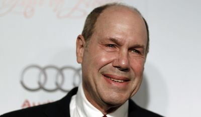 FILE - In this Thursday, March 1, 2012 file photo, Michael Eisner arrives at the Academy of Television Arts and Sciences 21st Annual Hall of Fame Gala in Beverly Hills, Calif.. Michael Eisner, the former chief executive of The Walt Disney Co., is in talks to buy English soccer club Portsmouth it was announced Thursday, March 23, 2017. The fourth-tier club says it has entered into a 70-day exclusivity agreement with Eisner for takeover talks to take place. (AP Photo/Matt Sayles, file)