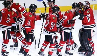 Chicago Blackhawks goalie Corey Crawford, right, celebrates with teammates after they defeated the Dallas Stars 3-2 in a shootout during an NHL hockey game Thursday, March 23, 2017, in Chicago. (AP Photo/Nam Y. Huh)