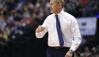 """FILE - In this March 17, 2017, file photo, Michigan coach John Beilein yells from the sideline during the first half of a first-round game against Oklahoma State in the NCAA men's college basketball tournament in Indianapolis. When Michigan was slumping earlier in the season, Beilein started thinking Super Bowl, not Final Four. Beilein conjured up the highlight-reel catch that Patriots receiver Julian Edelman made during New England's game-tying drive in the Super Bowl, and said the Wolverines should keep that sort of play--an outlier, as he called it--in mind.""""The point with the Super Bowl catch was that Edelman, he willed that catch,"""" Beilein said Wednesday, March 22. """"We have to will stuff to happen. You have to work hard. I really stressed the outlier things, too."""" (AP Photo/Jeff Roberson)"""