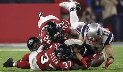 FILE - In this Sunday, Feb. 5, 2017, file photo, New England Patriots' Julian Edelman makes a catch as Atlanta Falcons' Ricardo Allen and Keanu Neal defend, during the second half of the NFL Super Bowl 51 football game in Houston. When Michigan was slumping earlier in the season, the coach started thinking Super Bowl, not Final Four. John Beilein conjured up the highlight-reel catch that Edelman made during New England's game-tying drive in the Super Bowl, and said the Wolverines should keep that sort of play, an outlier, as he called it, in mind. (AP Photo/Patrick Semansky, File)