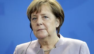 German Chancellor Angela Merkel's political party, the Christian Democratic Union (CDU), won roughly 40 percent of the vote in Germany's western state of Saarland, which is considered a bellwether state. The CDU victory suggests Mrs. Merkel's hold on power is stronger than some predicted. (AP Photo/Michael Sohn)