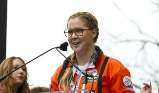 In this Jan. 21, 2017, file photo, comedian Amy Schumer speaks to the crowd during the Women's March rally in Washington. Variety reported on March 23, 2017, that Schumer dropped out of a live-action big screen version of Barbie due to scheduling conflicts. ( AP Photo/Jose Luis Magana, File)