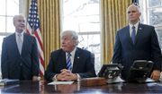 President Donald Trump, flanked by Health and Human Services Secretary Tom Price, left, and Vice President Mike Pence, right, before addressing members of the media regarding the health care overhaul bill, Friday, March 24, 2017, in the Oval Office of the White House in Washington. (AP Photo/Pablo Martinez Monsivais)