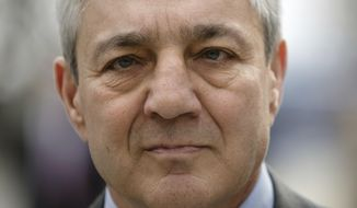 Former Penn State president Graham Spanier walks from the Dauphin County Courthouse in Harrisburg, Pa., Friday, March 24, 2017. Spanier was convicted Friday of hushing up suspected child sex abuse in 2001 by Jerry Sandusky, whose arrest a decade later blew up into a major scandal for the university and led to the firing of beloved football coach Joe Paterno. (AP Photo/Matt Rourke)