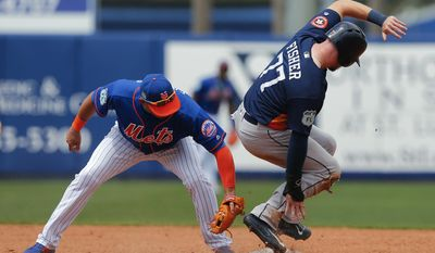 Houston Astros left fielder Derek Fisher (77) steals second base as New York Mets shortstop Asdrubal Cabrera (13) applies the late tag in the fifth inning of a spring training baseball game Friday, March 24, 2017, in Port St. Lucie, Fla. (AP Photo/John Bazemore)