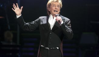 """FILE - In this March 17, 2016 file photo, Barry Manilow performs in concert during his """"One Last Time! Tour 2016"""" in Hershey, Pa. The Grammy Award-winning singer of such songs as """"Mandy,"""" """"I Write the Songs"""" and """"Looks Like We Made It"""" will appear at the next monthly """"Concert for America: Stand Up, Sing Out!"""" on April 18 at The Town Hall in New York. It also will be streamed live on Facebook. (Photo by Owen Sweeney/Invision/AP, File)"""