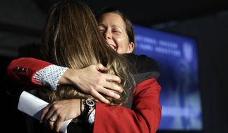 Shannon MacMillan, right, hugs fellow inductee Brandi Chastain during an induction ceremony for the National Soccer Hall of Fame on Friday, March 24, 2017, in San Jose, Calif. (AP Photo/Marcio Jose Sanchez)