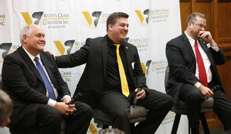 Libertarian candidate Chris Rockhold's campaign manager, Jordan Husted, center, jokes with Republican Ron Estes, left, about his attendance to debates as Democrat James Thompson looks on Thursday, March 23, 2017, before the start of a debate hosted by the Wichita Crime Commission. Thompson, Estes and Rockhold are running for the seat given up by Mike Pompeo when he became CIA Director. (Bo Rader/The Wichita Eagle via AP)