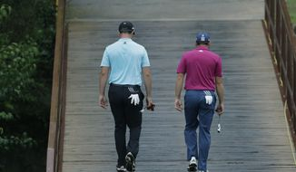 Sergio Garcia, of Spain, right, walks with compatriot and playing partner Jon Rahm on the third hole during round-robin play at the Dell Technologies Match Play golf tournament at Austin County Club, Friday, March 24, 2017, in Austin, Texas. (AP Photo/Eric Gay)