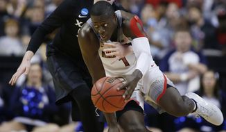 Xavier guard J.P. Macura, left, defends on Arizona guard Rawle Alkins (1) during the first half of an NCAA Tournament college basketball regional semifinal game Thursday, March 23, 2017, in San Jose, Calif. (AP Photo/Tony Avelar)