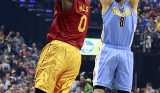 Denver Nuggets forward Danilo Gallinari (8) shoots as Indiana Pacers forward C.J. Miles defends during the first half of an NBA basketball game, Friday, March 24, 2017, in Indianapolis. (AP Photo/R Brent Smith)