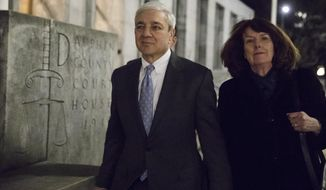 Former Penn State president Graham Spanier walks from the Dauphin County Courthouse in Harrisburg, Pa., Thursday, March 23, 2017. The jury in Spanier's criminal trial is going home after hours of deliberations without reaching a verdict. (AP Photo/Matt Rourke)