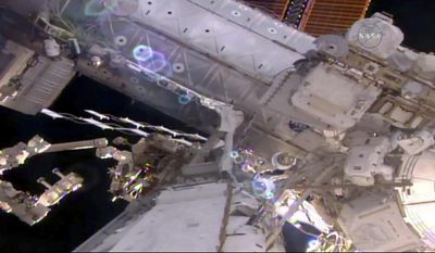 This still image taken from live video provided by NASA shows astronaut Shane Kimbrough, right, works on the International Space Station during a space walk on Friday, March 24, 2017.    Kimbrough and France's Thomas Pesquet emerged early from the orbiting complex, then went their separate ways to accomplish as much as possible 250 miles up. Their main job involves disconnecting an old docking port. This port needs to be moved in order to make room for a docking device compatible with future commercial crew capsules. (NASA via AP)