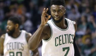 Boston Celtics forward Jaylen Brown (7) gestures after making a 3-point shot against the Phoenix Suns during the first quarter of an NBA basketball game, Friday, March 24, 2017, in Boston. (AP Photo/Elise Amendola)
