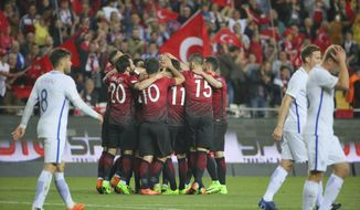 Turkey's players celebrate after scoring against Finland, during the 2018 World Cup qualifying Group I soccer match between Turkey and Finland, in Antalya, Turkey, Friday, March 24, 2017. (AP Photo)