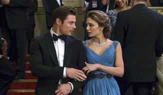 """This image released by E! Entertainment shows Josh Henderson as Kyle West, left, and Christine Evangelista as Megan Morrison in a scene from, """"The Arrangement.""""  It airs Sunday nights at 10 p.m. (Daniel Power/E! Entertainment via AP)"""