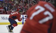 Washington Capitals left wing Alex Ovechkin (8) skates watching right wing T.J. Oshie (77) during the second period of an NHL hockey game against the Arizona Coyotes, Saturday, March 25, 2017, in Washington. (AP Photo/Molly Riley)