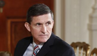 Then-National Security Adviser Michael Flynn sits in the East Room of the White House in Washington in this Feb. 10, 2017, file photo. (AP Photo/Carolyn Kaster, File)