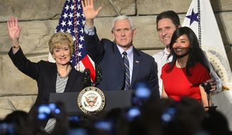 From left, SBA Administrator Linda McMahon, Vice President Mike Pence , Ronald Regan Foster, and Nancy Reagan Foster stand before a crowd on Saturday, March 25, 2017 in Charleston, W.Va.   Pence traveled to Charleston to talk about jobs and small businesses in the wake of a stinging defeat for the Trump administration on health care.  (Justin Rogers/Charleston Gazette-Mail via AP)
