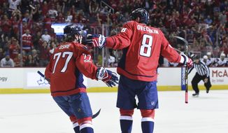 Washington Capitals left wing Alex Ovechkin (8) celebrates his goal with right wing T.J. Oshie (77) during the first period of the team's NHL hockey game against the Arizona Coyotes, Saturday, March 25, 2017, in Washington. (AP Photo/Molly Riley)