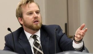 """FILE - In this March 15, 2017, file photo, Rep. James Grant, R-Tampa, speaks during a subcommittee meeting, in Tallahassee, Fla. Republican lawmakers have so far shown unwavering support for stricter policies on immigration, even when those opposing the measures say the language opens up local municipalities to """"frivolous litigation"""" for going against federal court rulings and in some cases the U.S. Constitution. Grant said the potential unconstitutionality of a bill should not prevent them from voting on what they think is right. """"I would encourage all of us to put the Florida Supreme Court in the position of telling us that we are wrong,"""" (AP Photo/Steve Cannon, File)"""