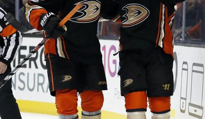 Anaheim Ducks right wing Jakob Silfverberg, left, of Germany, celebrates with left wing Andrew Cogliano, right, after Cogliano scored a goal during the second period of the team's NHL hockey game against the Winnipeg Jets, Friday, March 24, 2017, in Anaheim, Calif. (AP Photo/Ryan Kang)