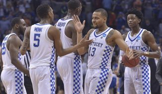 Members of the Kentucky team celebrate after an NCAA college basketball tournament South Regional semifinal game against UCLA, Friday, March 24, 2017, in Memphis, Tenn. Kentucky won 86-75. (AP Photo/Brandon Dill)