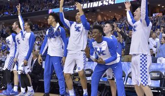The Kentucky bench cheers play against UCLA in the second half of an NCAA college basketball tournament South Regional semifinal game Friday, March 24, 2017, in Memphis, Tenn. (AP Photo/Brandon Dill)