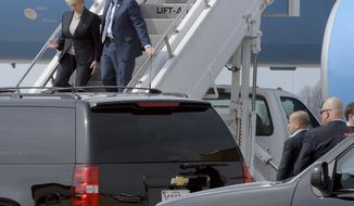 Vice President Mike Pence and Small Business Administrator Linda McMahon arrive at Yeager Airport in Charleston, W.Va., on Saturday, March 25, 2017 to travel by motorcade to Putnam County for a meeting with small business operators. (Chris Dorst/Charleston Gazette-Mail via AP)