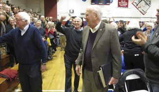 U.S. Senators Bernie Sanders, left, Patrick Leahy, right, and Rep. Peter Welch center, hold a town hall meeting with constituents Saturday, March 25, 2017, in Hardwick, Vt. The three-member congressional delegation called the defeat of the Republican health care plan a victory. (AP Photo/Lisa Rathke)