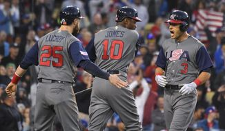 United States' Ian Kinsler, right, celebrates his two-run home run with Jonathan Lucroy, left, and Adam Jones during the third inning against Puerto Rico in the final of the World Baseball Classic in Los Angeles, Wednesday, March 22, 2017. (AP Photo/Mark J. Terrill)