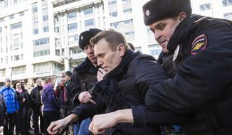 "In this photo provided by Evgeny Feldman, Alexei Navalny is detained by police in downtown Moscow, Russia, Sunday, March 26, 2017. Russia's leading opposition figure Alexei Navalny and his supporters aim to hold anti-corruption demonstrations throughout Russia. But authorities are denying permission and police have warned they won't be responsible for ""negative consequences"" or unsanctioned gatherings. (Evgeny Feldman for Alexey Navalny's campaign photo via AP)"