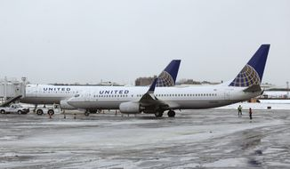 United Airlines airplanes sit on the tarmac at LaGuardia Airport in New York, Wednesday, March 15, 2017. (AP Photo/Seth Wenig)
